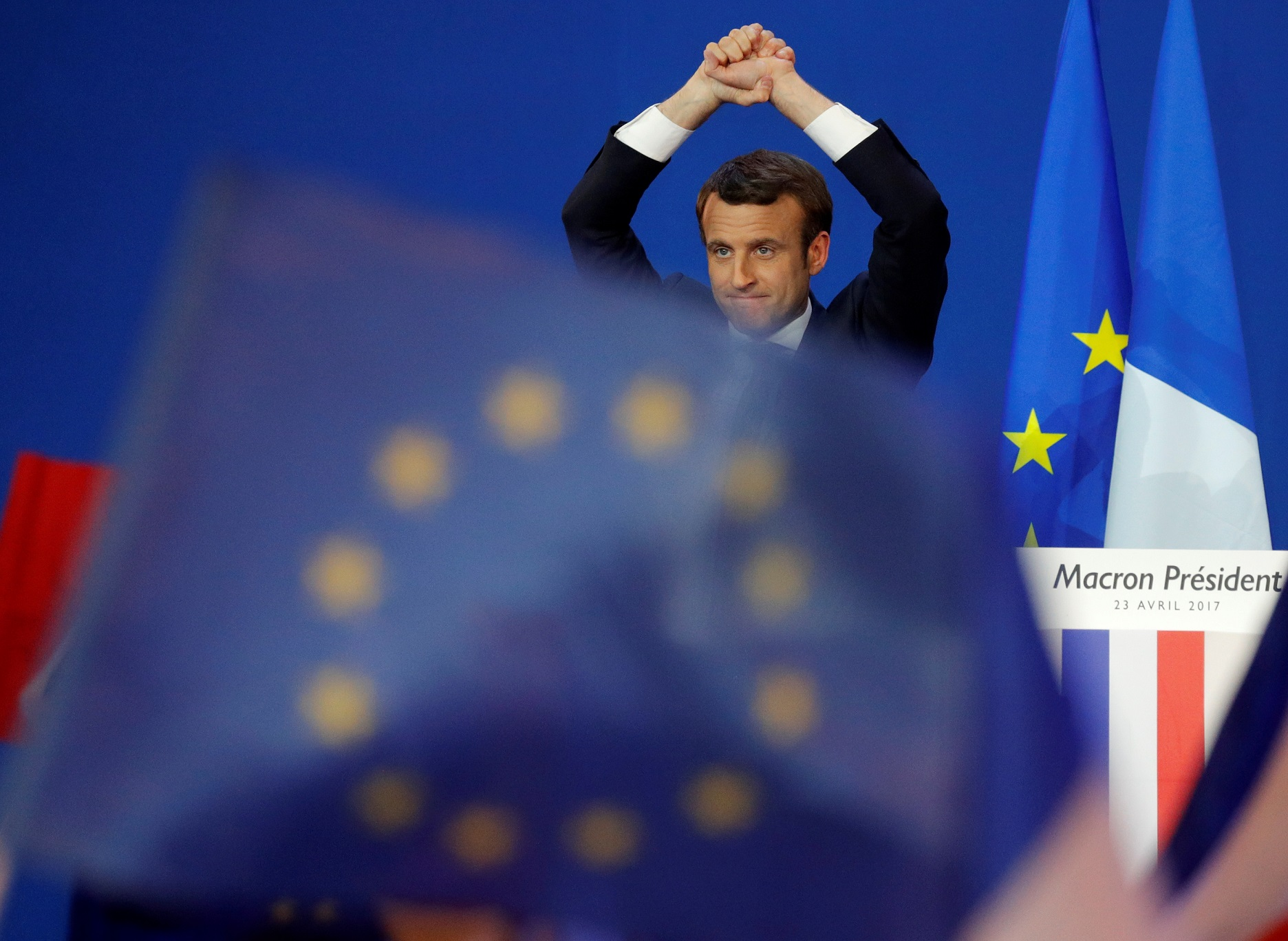 Emmanuel Macron, head of the political movement En Marche !, or Onwards !, and candidate for the 2017 French presidential election, celebrates on stage after partial results in the first round of 2017 French presidential election in Paris